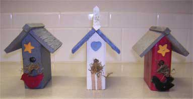 Three Decorative Bird Houses